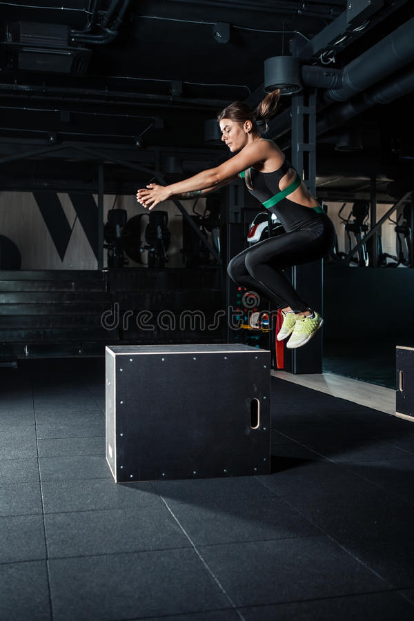 Young woman doing a box jump exercise. stock photo