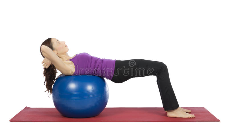 Young woman doing crunch on pilates ball royalty free stock images