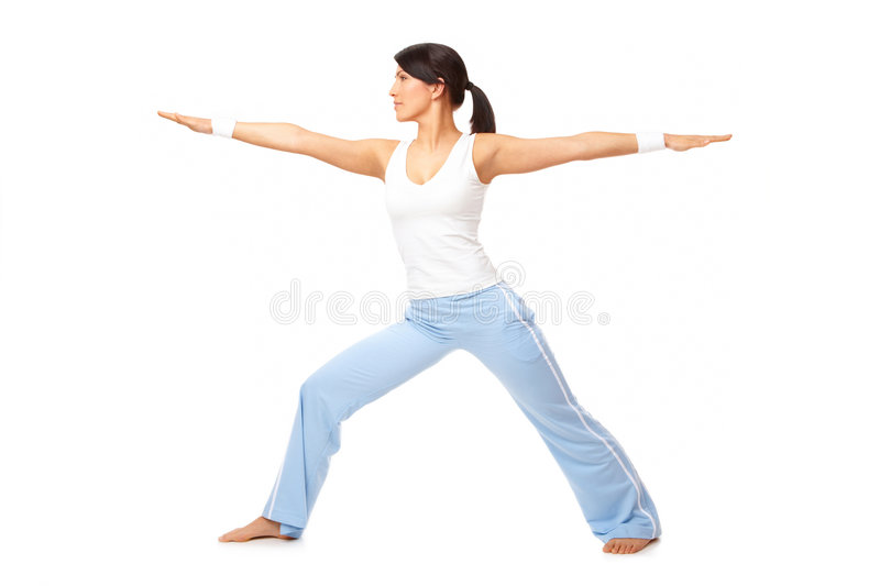 Young woman doing exercise stock images