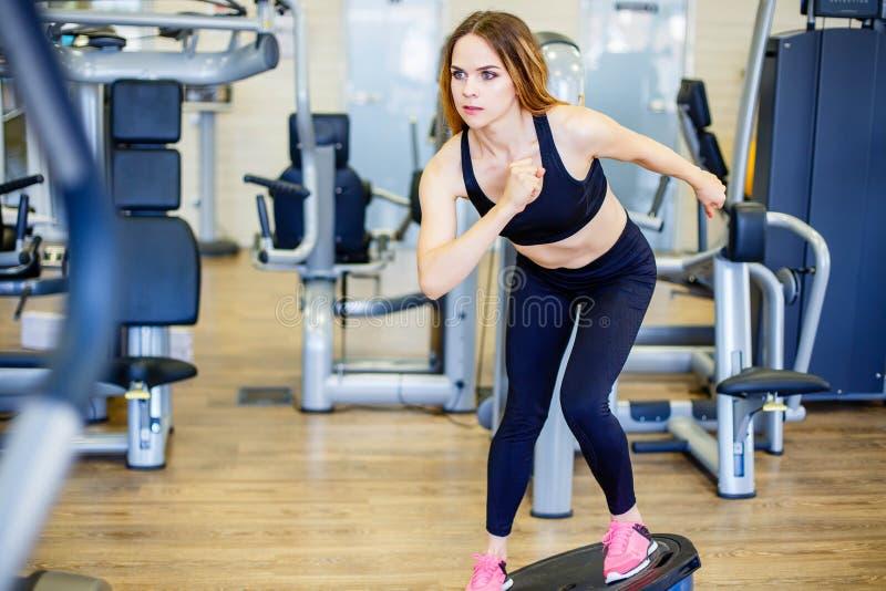 Young woman doing exercise on bosu ball. stock image