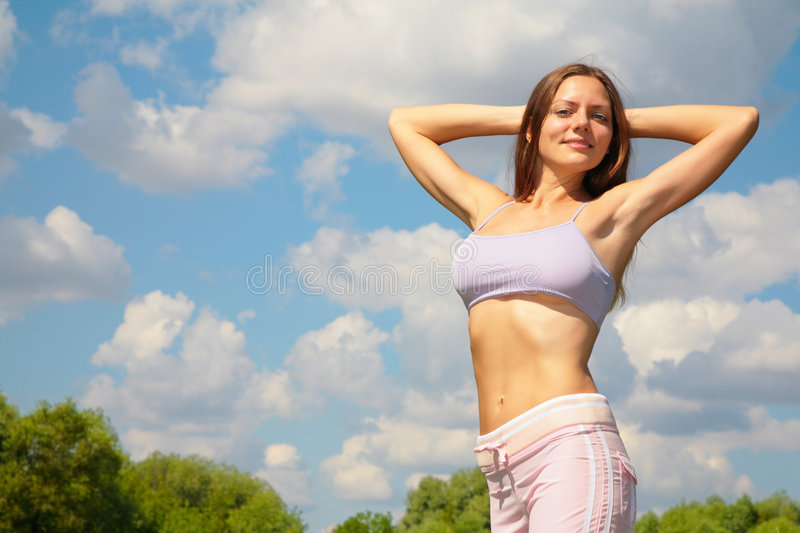 Young woman doing exercise in park stock image