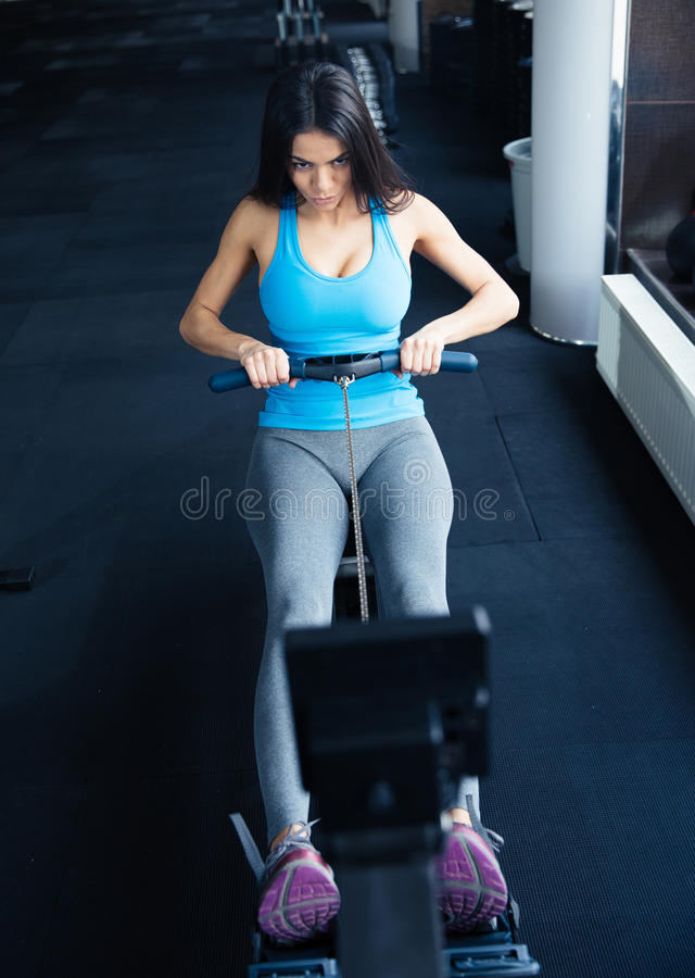 Young woman doing exercise on a simulator stock images