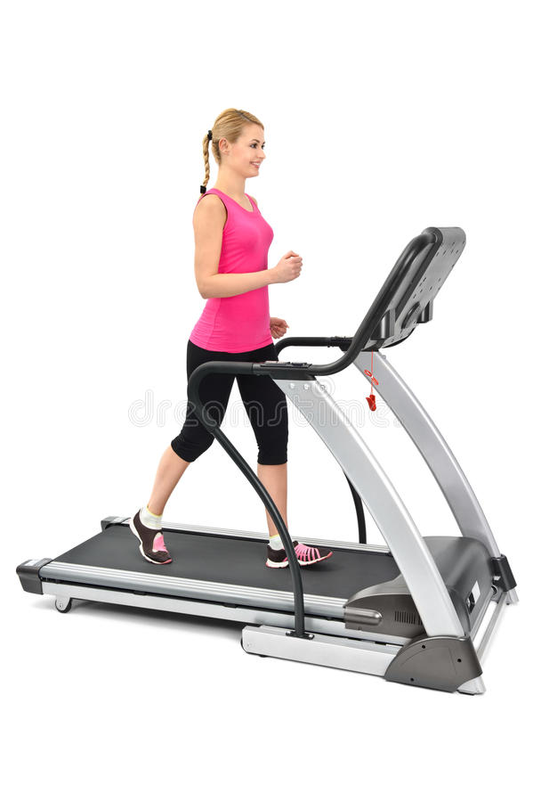 Download Young Woman Doing Exercises On Treadmill Stock Photo - Image: 23080088