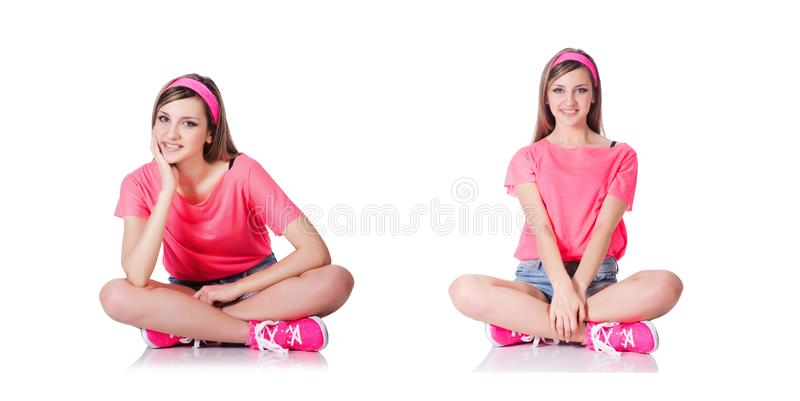 The young woman doing exercises on white stock images