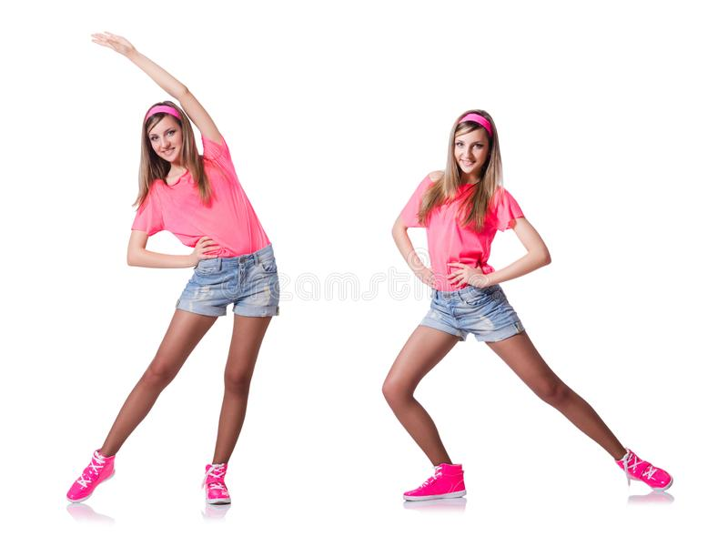 The young woman doing exercises on white stock photography