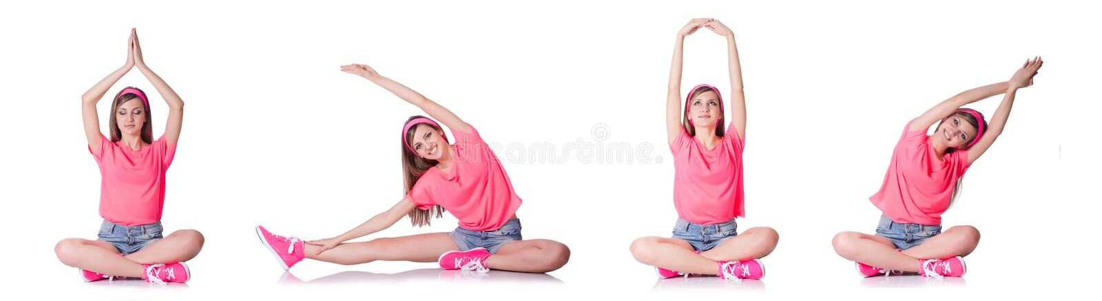 The young woman doing exercises on white stock image