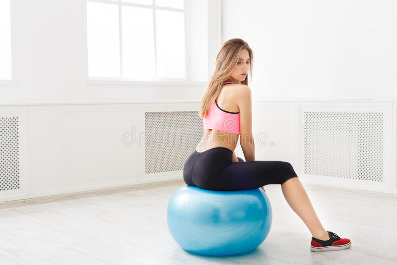 Young woman doing fitness exercises with fit ball stock images