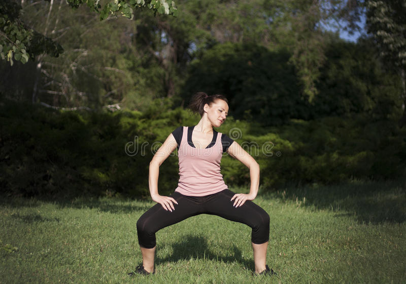 Young woman doing fitness outdoors stock image