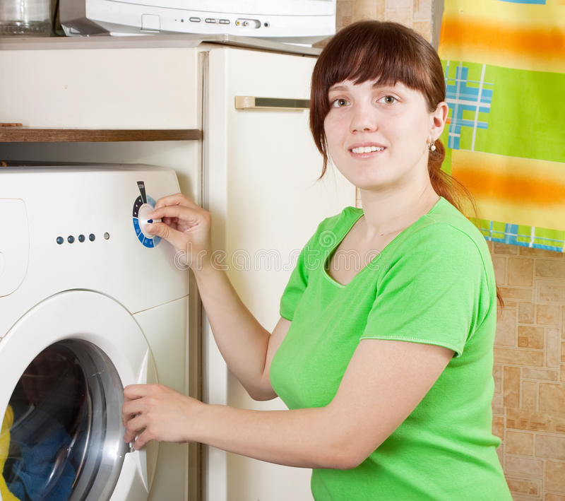 Download Young woman doing laundry stock photo. Image of household - 18746130