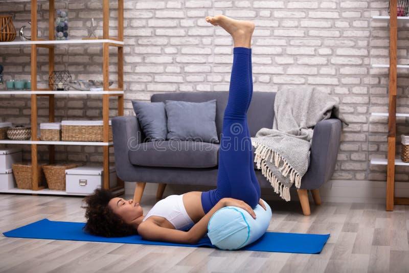 Woman Doing Leg Up Exercise stock photo