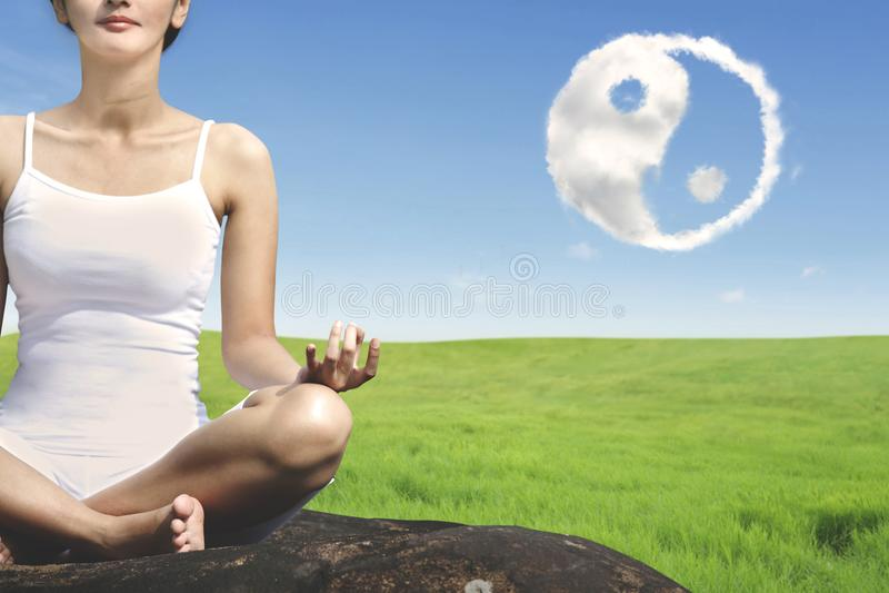 Young woman doing a meditation stock photos