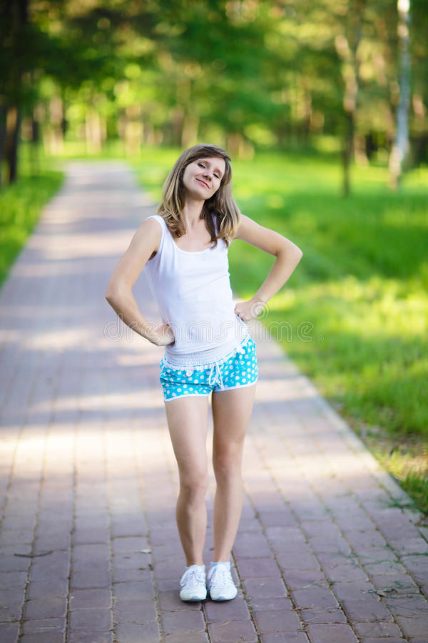 Young woman doing morning exercises on nature stock image
