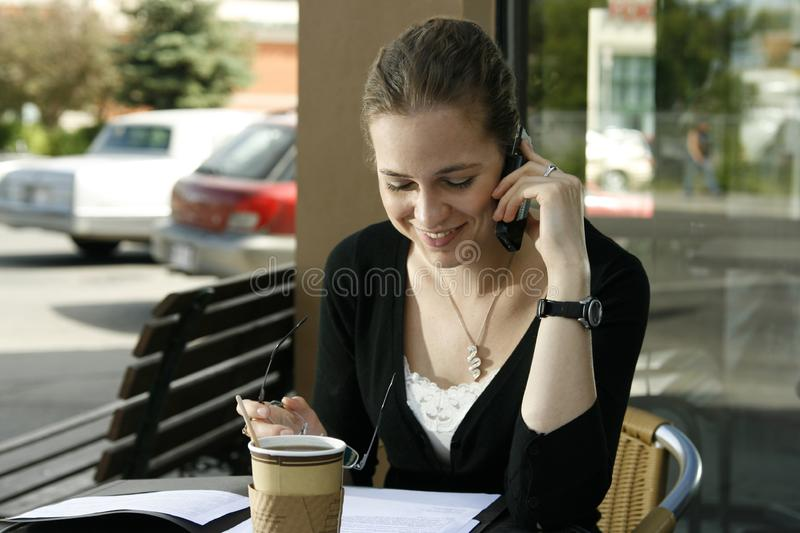 Young woman doing paperwork stock image