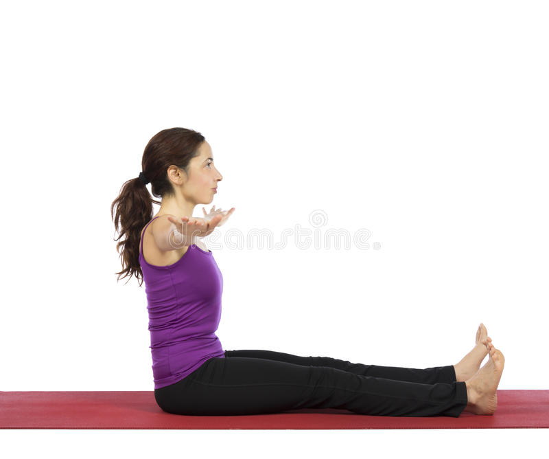Young woman doing pilates abs exercises stock photo