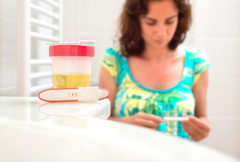 Young woman doing pregnancy test stock photo