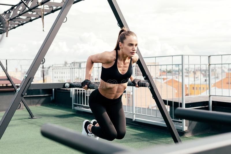 Young woman doing push ups at power rack stock images