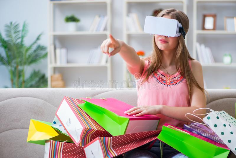 The young woman doing shopping with virtual reality glasses stock images