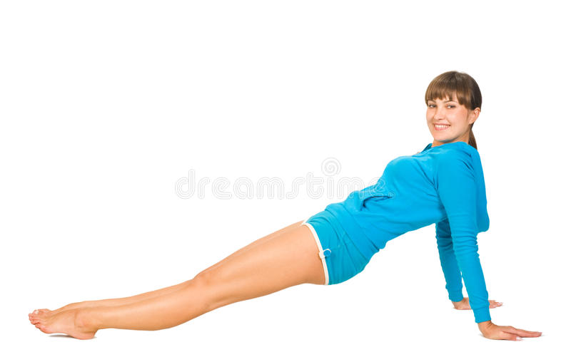 Young woman is doing some exercises stock photography