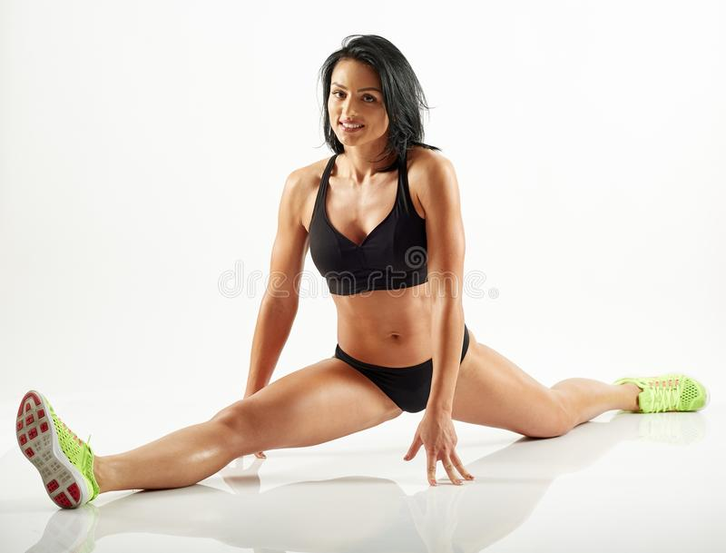 Young woman doing a split stock images