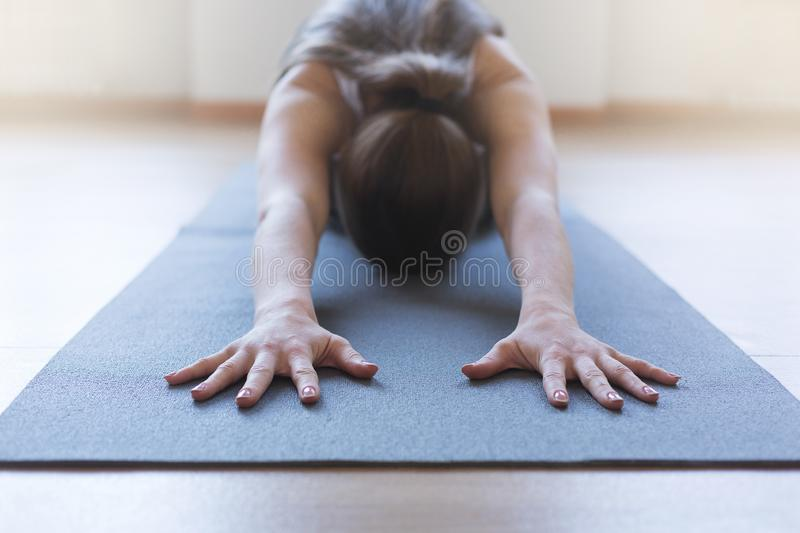 Young woman doing sport and stretching on mat, healthy lifestyle and fitness concept.  stock image