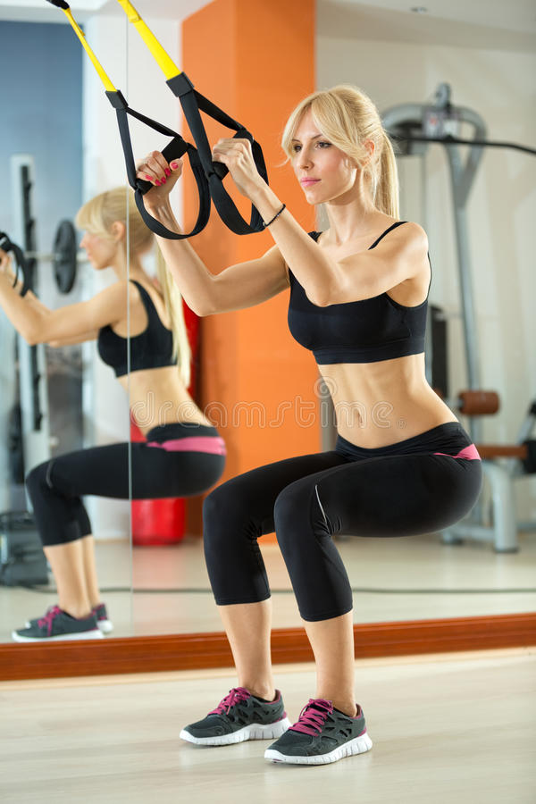 Young woman doing squats stock image