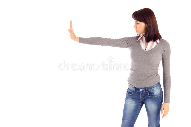 Young Woman Doing Stop Gesture. Young attractive woman showing stop gesture, isolated on white background royalty free stock photography