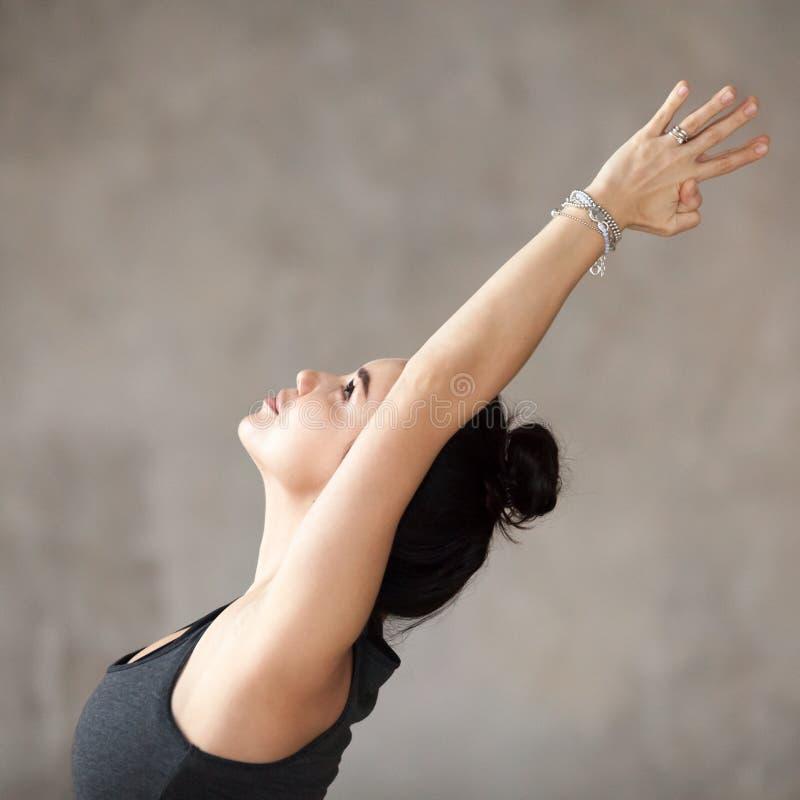 Free Young Woman Doing Virabhadrasana 1 Exercise Royalty Free Stock Photo - 110733505