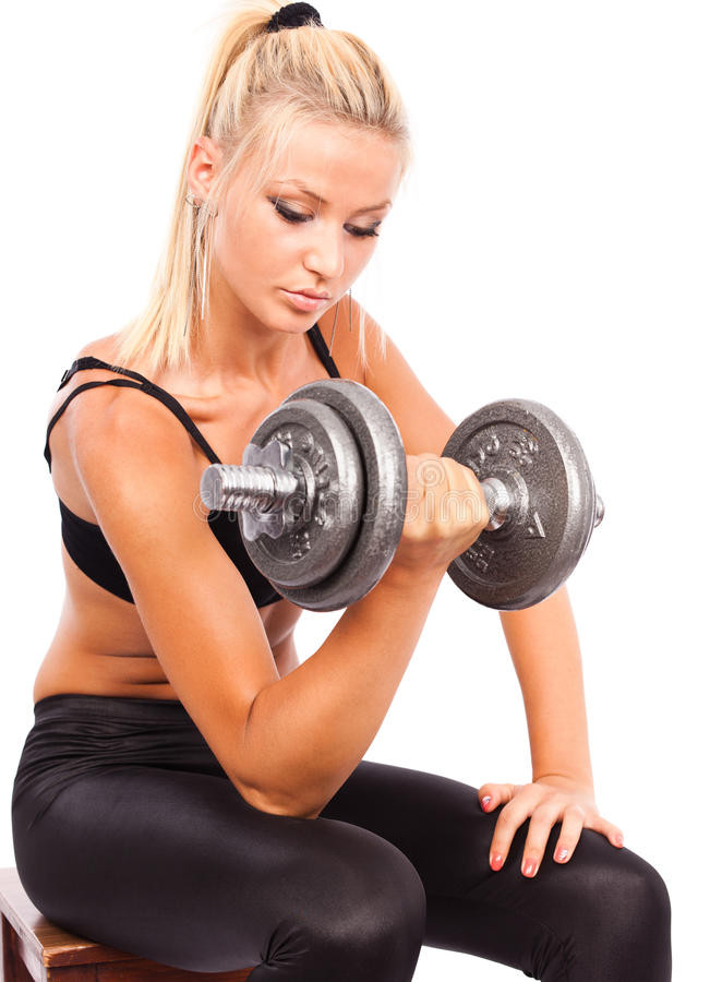 Download Young woman doing workout stock photo. Image of dumbbell - 20825252