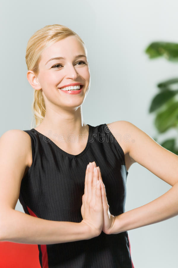 Young woman doing yoga. Woman doing yoga moves, or meditating royalty free stock images