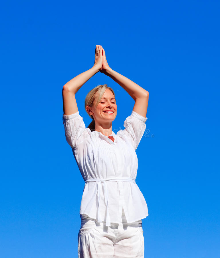 Download Young woman doing yoga stock photo. Image of alternative - 9743310
