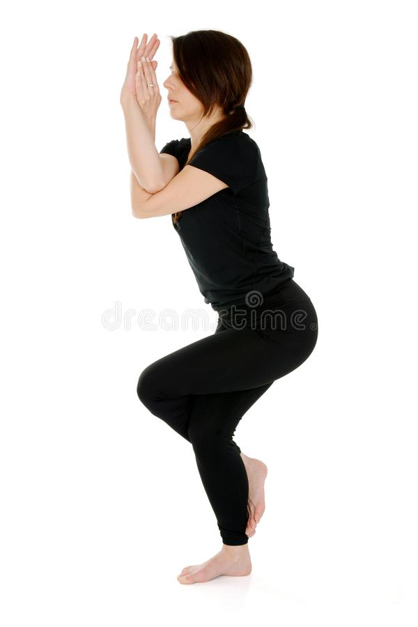 Young woman doing yoga asana Garudasana Eagle Pose royalty free stock photos
