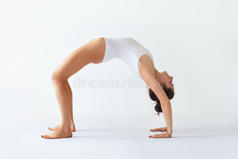 Young woman doing yoga asana Upward Bow Wheel Pose. Urdhva Dhanurasana stock photos