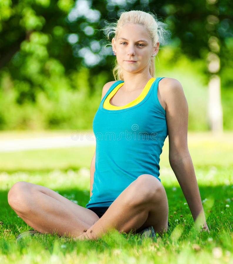 Download Young Woman Doing Yoga Exercise Stock Photo - Image of forest, girl: 21561744