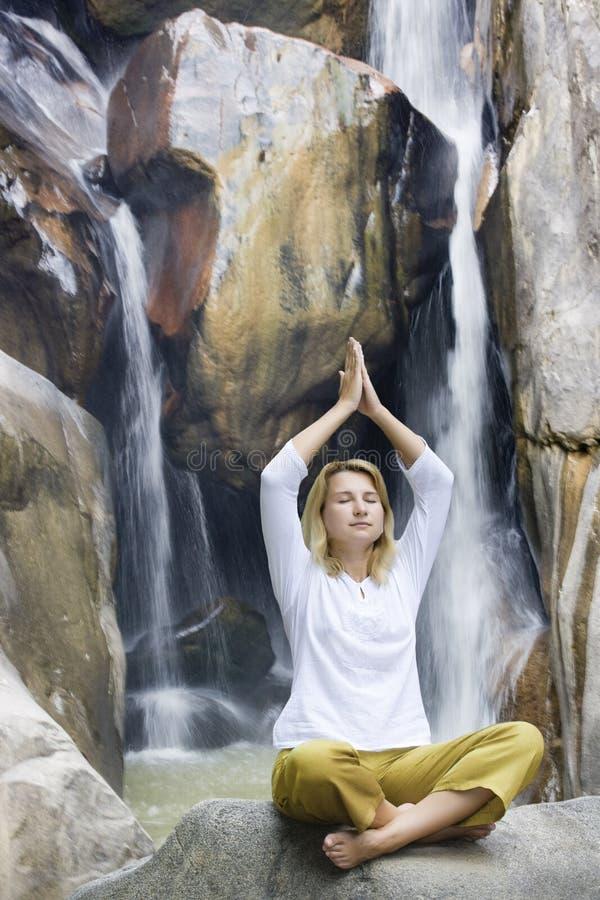 Young woman doing yoga exercises stock photography