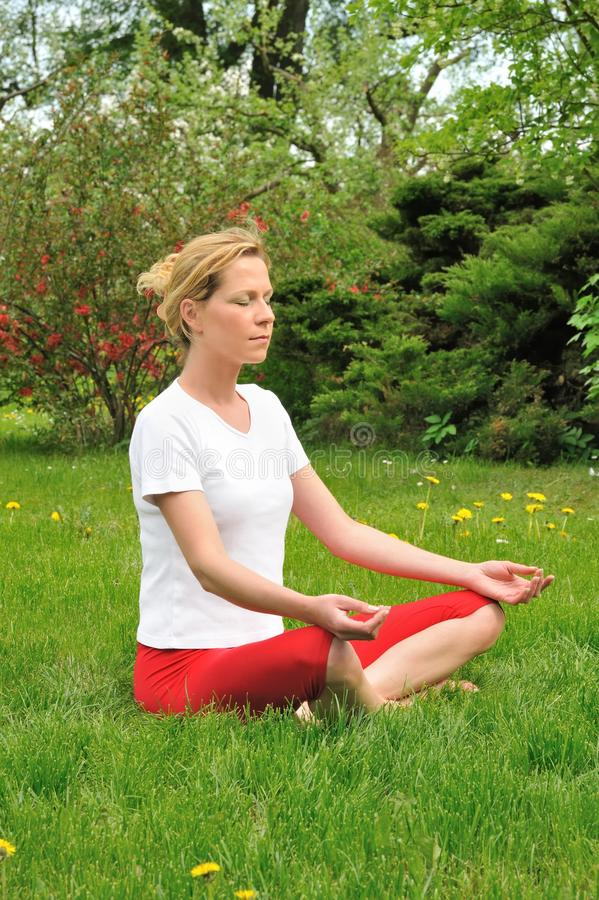 Young Woman Doing Yoga - Meditation Stock Image