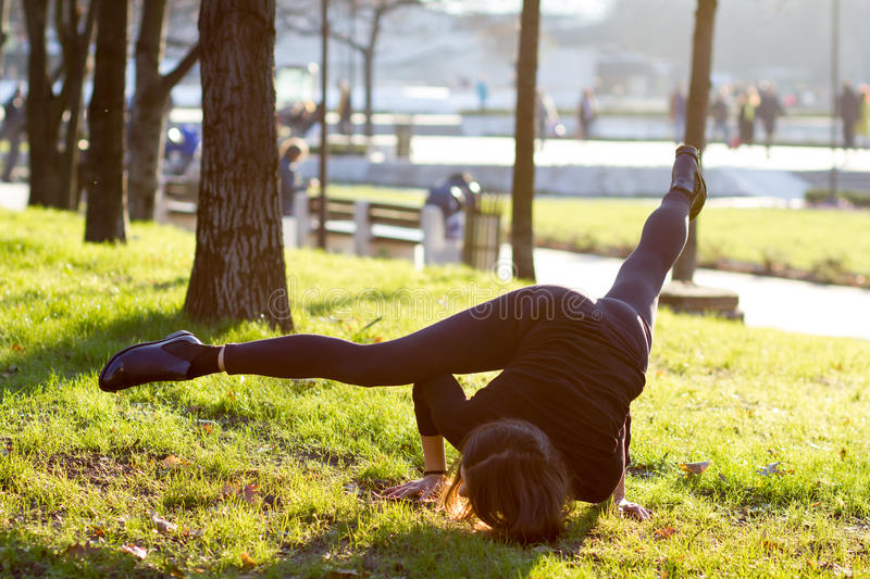 Young woman doing yoga in park royalty free stock image