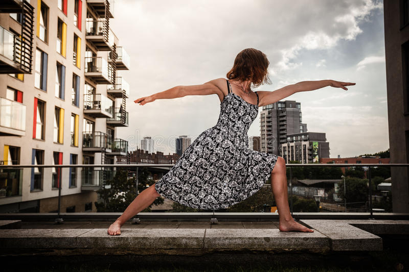 Download Young Woman Doing Yoga On Roof Top Stock Image - Image: 42173647