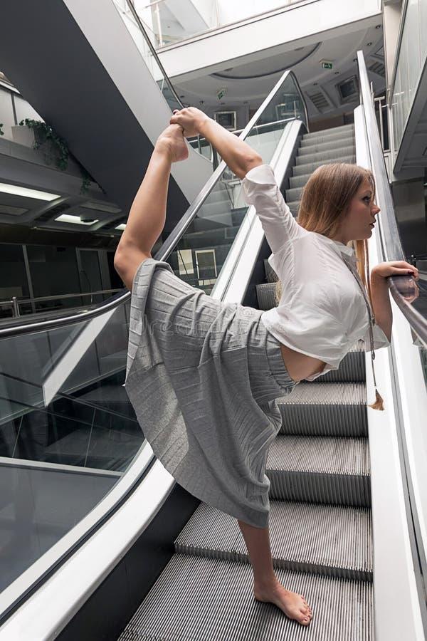 Young woman doing yoga. Urban Yoga. Yoga pose. royalty free stock photo