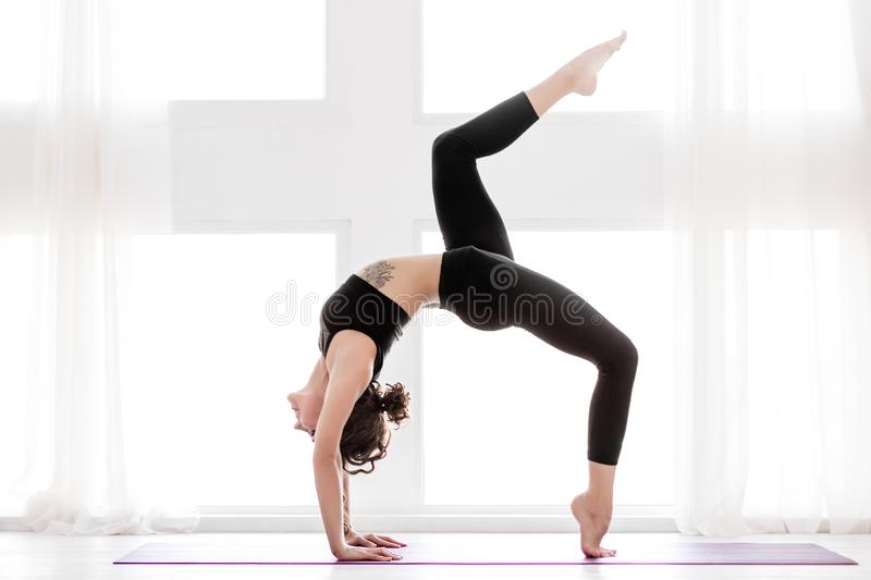 Young woman doing yoga workout at home royalty free stock photography