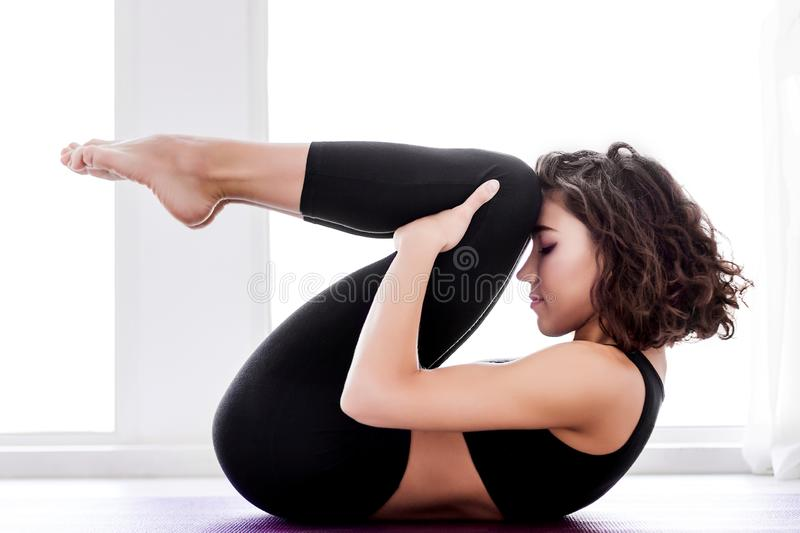 Young woman doing yoga workout at home stock images