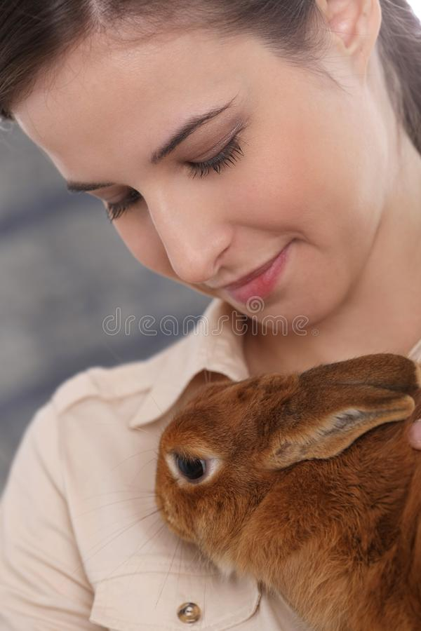 Young Woman With Domestic Rabbit Stock Photo