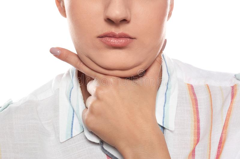 Young woman with double chin on white background royalty free stock photography