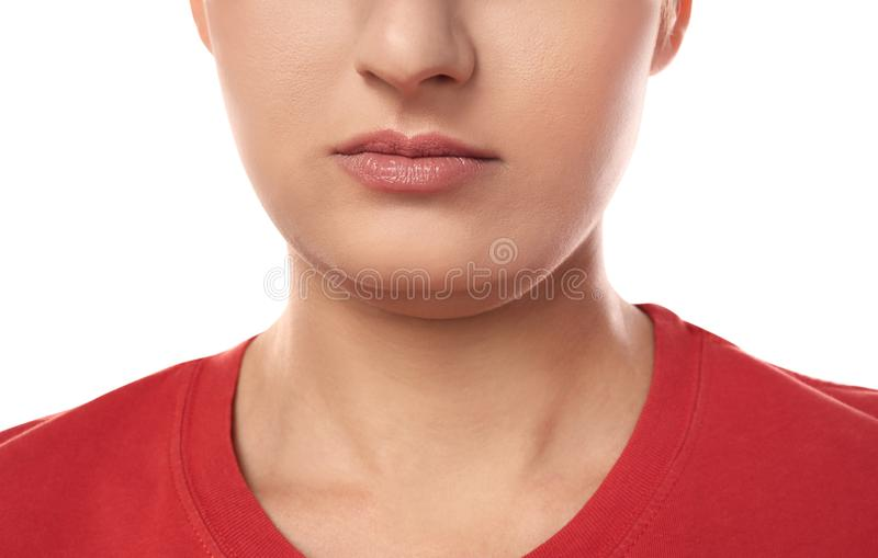 Young woman with double chin on white background stock image