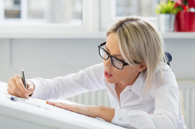 Young woman drawing blueprint royalty free stock photo