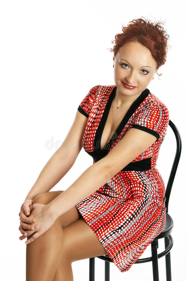 Young woman in a dress stock image