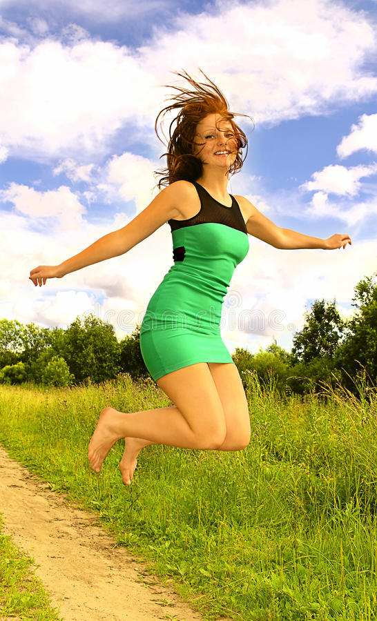 Download Young Woman In Dress Jumping Up Stock Photo - Image: 26396340
