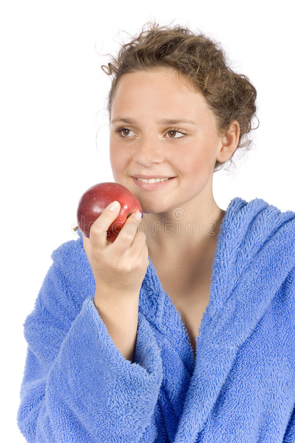Young woman dressed blue bathrobe with an apple stock image