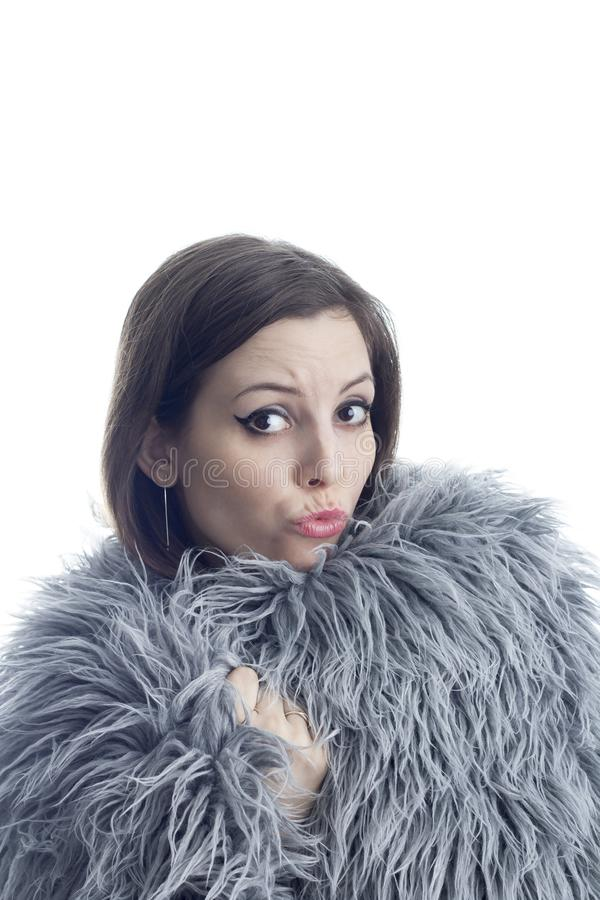 A young woman dressed in fur royalty free stock images