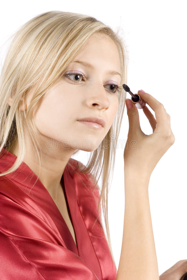 Young Woman Dressed Red Bathrobe Putting Mascara Stock Image