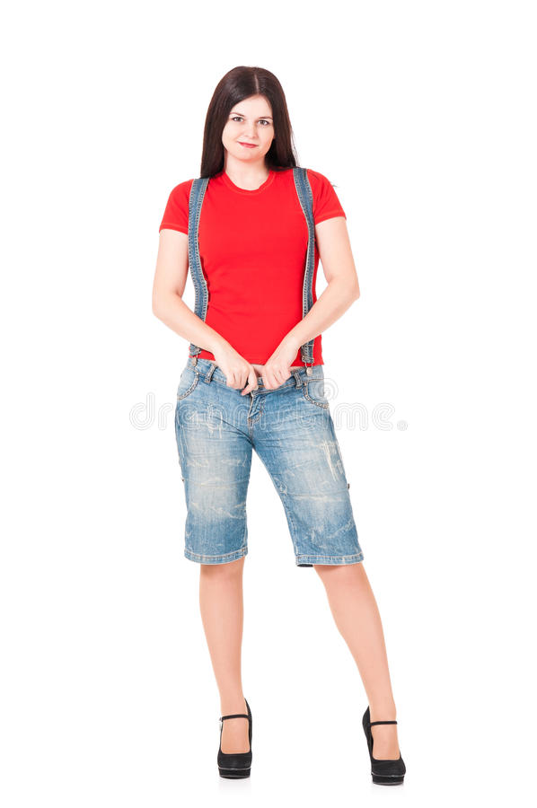 Young woman. Dressed in shorts and a t-shirt isolated on white background cutout royalty free stock images